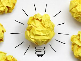 Inspiration concept crumpled paper light bulb metaphor for good idea